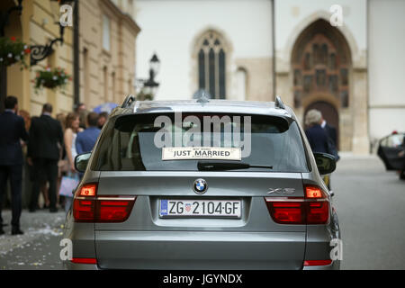 ZAGREB, CROATIA - MAY 20, 2017 : A Just Married sign on the back window of a parked car in Zagreb, Croatia. - Stock Photo