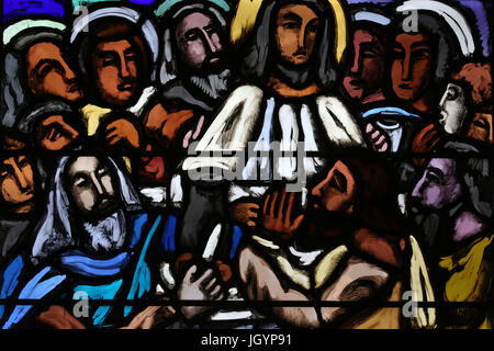 Saint-Joseph church.  Stained glass window. The Last Supper. The final meal that Jesus shared with his Apostles - Stock Photo