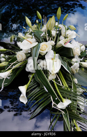 Wedding bouquet on a car. France. - Stock Photo