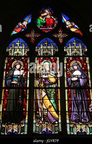 St Paul church. Stained glass window. St. Margaret Mary Alacoque, Bishop Francis de Sales, Jane Frances de Chantal. - Stock Photo