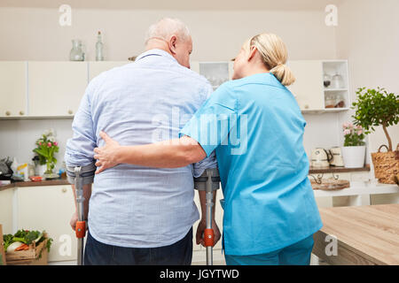 Physiotherapy or rehab for senior man gets help from nurse - Stock Photo