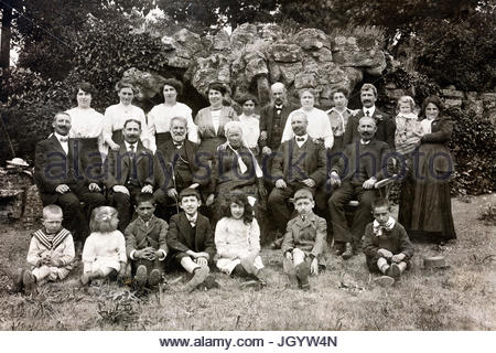 large group family posing with children and elderly 1920s France - Stock Photo