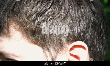the hair of a young man, close up. - Stock Photo