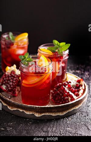 Pomegranate sangria with oranges - Stock Photo