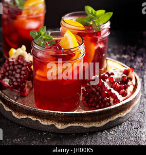 Pomegranate sangria with oranges - Stock Photo
