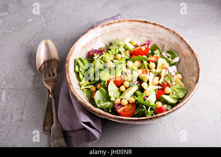 Salad with fresh vegetables and chickpeas - Stock Photo