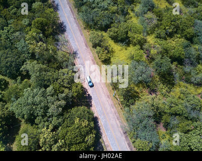Car on road aerial view from drone in rural area - Stock Photo