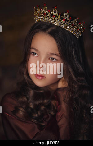 Portrait of cute girl wearing a crown. Young queen or princess - Stock Photo