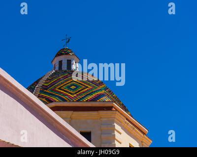 San Michele dome in Alghero on a sunny day. Sardinia, Italy - Stock Photo