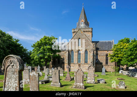 Old tombstones at cemetery of the 13th century Dornoch Cathedral, parish church in the Church of Scotland, Sutherland, - Stock Photo