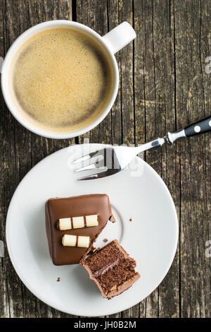 Sweet chocolate dessert on dessert plate and coffee cup. Top view. - Stock Photo