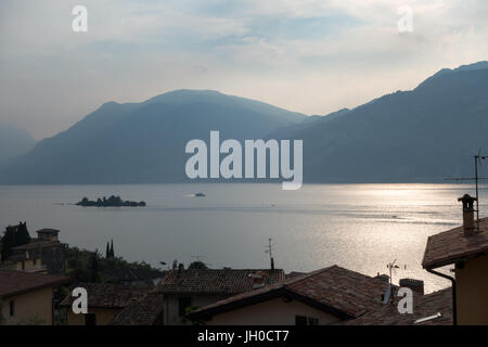 Evening view over Lake Garda, the largest lake in Italy. As seen from Cassone, located on the eastern shore of the - Stock Photo