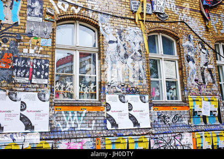 Graffiti covered exterior of old factory building in the Friedrichshain-Kreuzberg area of Berlin, Germany, a popular - Stock Photo