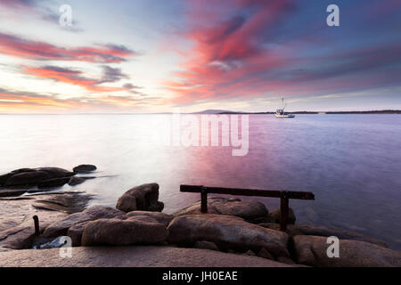A beautiful pink sunrise over the calm harbour of Port Lincoln in South Australia. - Stock Photo