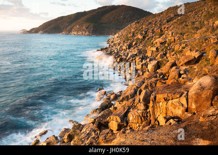A rugged expanse of untouched coastline at sunrise in eastern Australia. - Stock Photo