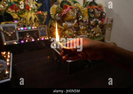 Hindu devotee celebrating Diwali festival. France. - Stock Photo