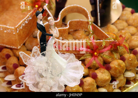 Bride And Groom Figurines On Wedding Cake.  Moulins. France. - Stock Photo