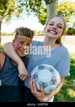 Austria Fans with colours in face celebrating together, Vienna, Austria - Stock Photo