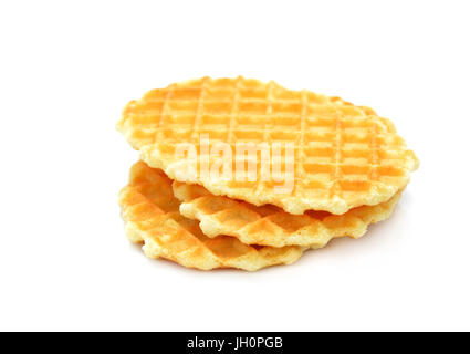 A stack of golden round waffles isolated on white background.Set of three tasty brown biscuits. - Stock Photo