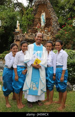 Assumption celebration outside Battambang catholic church, Battambang. Cambodia. - Stock Photo