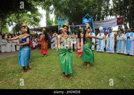 Assumption celebration outside Battambang catholic church, Battambang. Traditional dancers. Cambodia. - Stock Photo