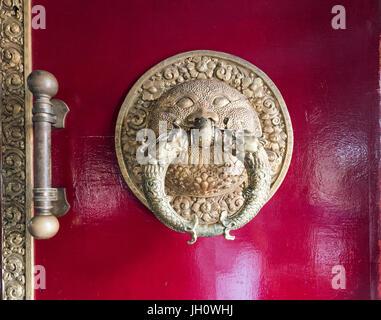 Metal door knocker in golden temple Namdroling Monastery Tibetan Monastery at Coorg Karnataka India - Stock Photo