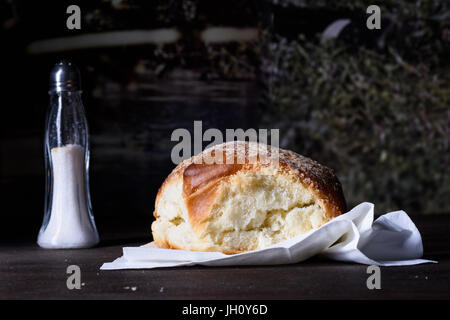 Baked burger bun,  fresh pastry on wooden counter top, close-up, copy space. - Stock Photo