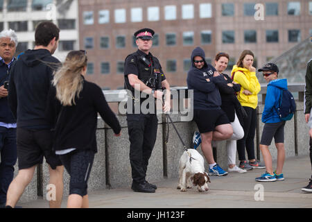 Metropolitan Police Dogs team on the London Bridge after the road is closed to traffic after the London Bridge Terror - Stock Photo