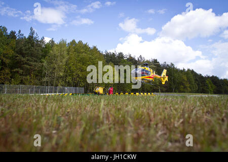 Polish Helicopter Emergency Medical Service (HEMS) Eurocopter 135 take off to action. - Stock Photo