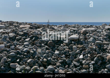 A natural seawall of granite boulders  at Seawall on Mt Desert Island Maine - Stock Photo
