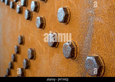 Rusty bolts hold a girder on a bridge - Stock Photo