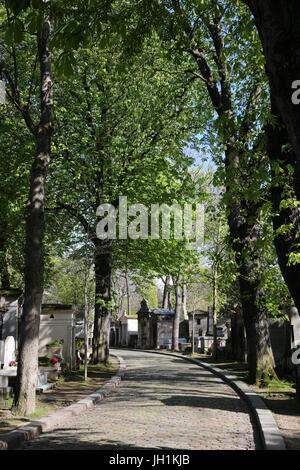 Cobblestone path leading to Pere Lachaise cemetery.  Paris. France. - Stock Photo