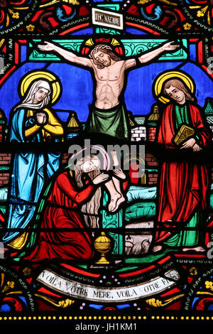 Sacred heart church. Crucifixion of Jesus Christ. Stained glass window.  Moulins. France. - Stock Photo