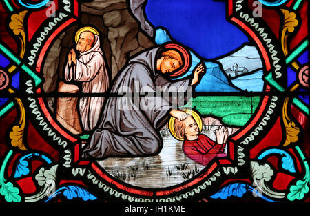 Sacred heart church. Stained glass window. Benedict of Nursia. St. Benedict is the patron saint of Europe and students. - Stock Photo