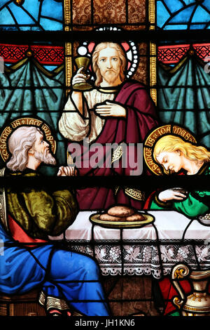 Moulins cathedral. Stained glass window. The Last Supper is the final meal that Jesus shared with his Apostles in - Stock Photo
