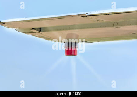 Wing of an airplane with position lighting. - Stock Photo