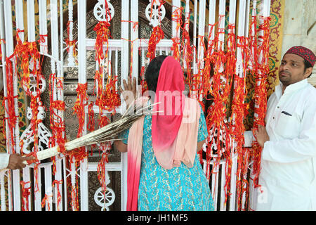 Ajmer Sharif dargah, Rajasthan. Pilgrim touched with peacock feathers used to clean the tomb shrine. India. - Stock Photo