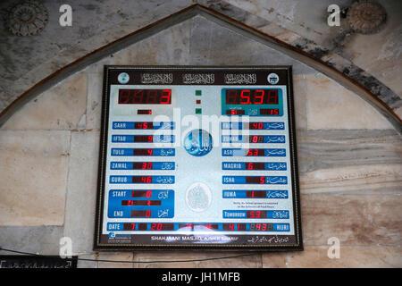 Ajmer Sharif dargah, Rajasthan. Shah Jahan mosque. Clock with prayer times. India. - Stock Photo