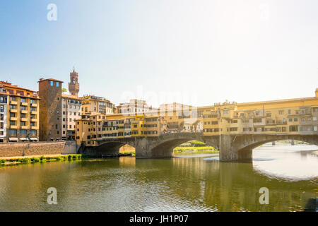 Medieval stone bridge Ponte Vecchio over the Arno River in Florence, Tuscany, Italy. Florence is a popular tourist - Stock Photo