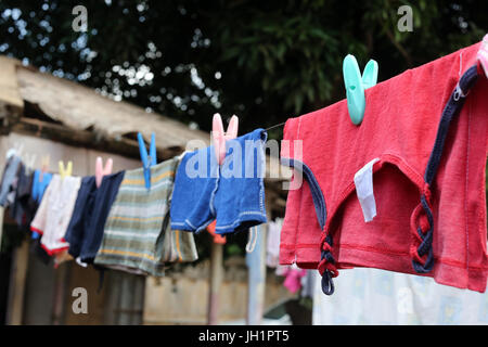Colored clothes on the line.  Lome. Togo. - Stock Photo