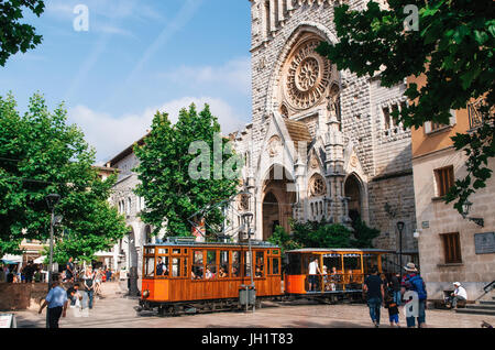 Port de Soller, Mallorca, Spain - May 26, 2016: Old tram in Soller in front of medieval gothic cathedral with huge - Stock Photo