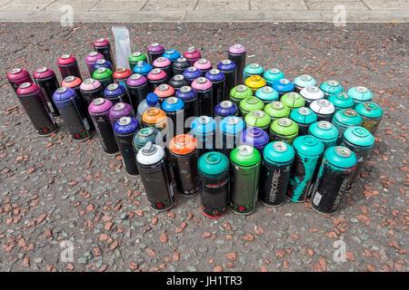 Used Hardcore aerosol spray paint cans - Stock Photo