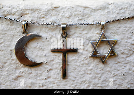 Symbols of islam, christianity and judaism. - Stock Photo