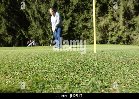 Chamonix golf. Golf player. France. - Stock Photo