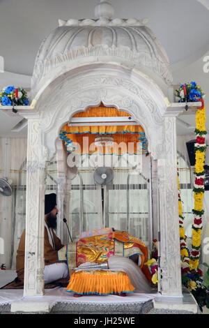 Gurdwara Sahib Silat Road ( Silat Road Sikh Temple ).  Bhai Maharaj Singh Memorial.  Tha Palki.   Guru Granth Sahib - Stock Photo