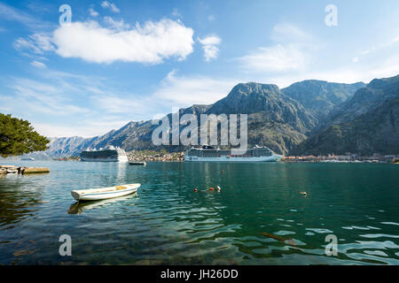 Cruise ships in the Bay of Kotor, UNESCO World Heritage Site, Montenegro, Europe - Stock Photo