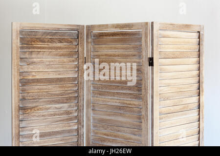 Close up of wooden folding screen on white background. - Stock Photo