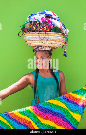 Local woman with basket on her head selling souvenir scarves and jewellery, Espargos, Santa Maria, Sal island, Cape - Stock Photo
