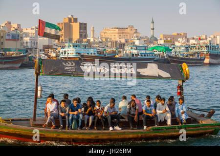 View of Deira District and boats on Dubai Creek, Bur Dubai, Dubai, United Arab Emirates, Middle East - Stock Photo