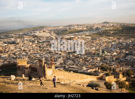 View over city from Merenid Tombs at sunset, Fes, Morocco, North Africa, Africa - Stock Photo